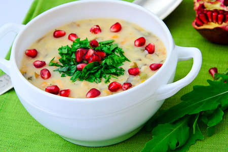 Healthy and Diet Food: Soup of Fish with Pomegranate. Studio Photo