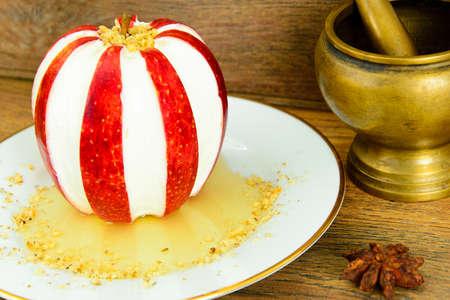membrillo: Apple Stuffed with Cream Cheese Dietary Food. Brunch. Studio Photo
