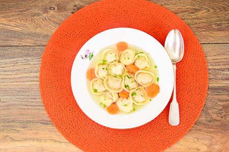 Delicious Food: Soup Dumplings Pelmeni and Carrot. Studio Photo