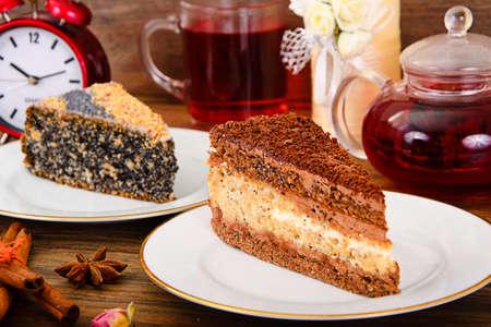 Homemade Cakes: Poppy Filling Cake on Plate. Studio Photo