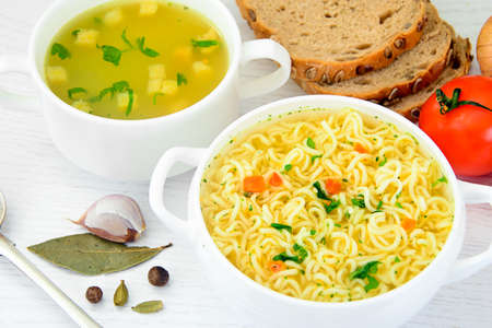 Chicken Soup with Noodles on Plate Studio Photo