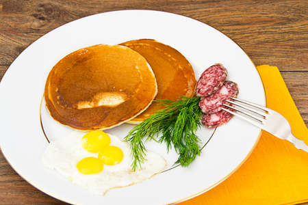 shrove: Pancakes with Quail Eggs, Cold Meats, Pastry Spoon with Black Caviar Studio Photo