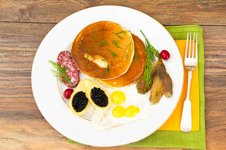 Pancakes with Quail Eggs, Cold Meats, Pastry Spoon with Black Caviar Studio Photo