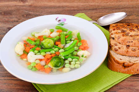 Soup with Cauliflower, Brussels Sprouts, Green Beans, Peas, Carrots and Mushrooms. Studio Photo Stock Photo