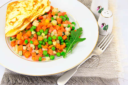 scrambled: Healthy and Diet Food: Scrambled Eggs with Vegetables. Studio Photo