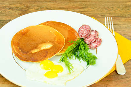 blini: Pancakes with Quail Eggs, Cold Meats, Pastry Spoon with Black Caviar. Studio Photo Stock Photo