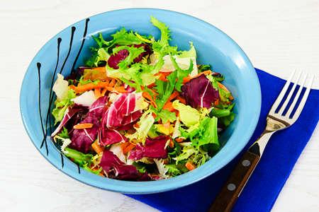 Mixed salad arugula, chard, corn, carrots, mesklan and iceberg Studio Photo Stock Photo