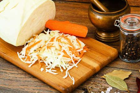 finocchio: Sauerkraut, Carrot, Salt, Water, Fennel Seeds and Pepper on Wood Background Studio Photo