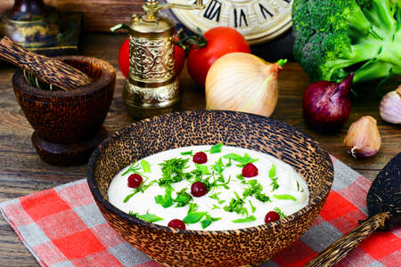 Parsnip Puree Soup with Cream, Dill, Onion, Cranberries Studio Photo