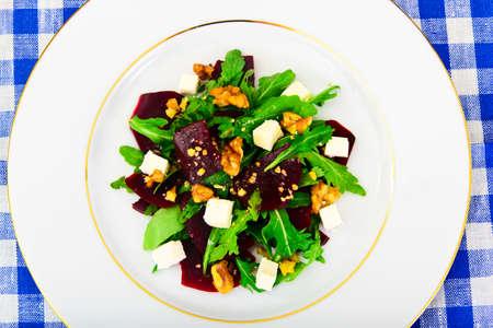 finocchio: Arugula Salad, Boiled Beets, Cheese and Walnuts Studio Photo