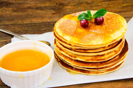 blini: Tasty Pancakes with Cranberry Stack Studio Photo