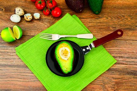 Avocados, Baked with Quail Egg, Salt, Pepper and Lemon Studio Photo