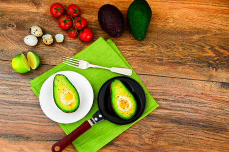 bacon love: Avocados, Baked with Quail Egg, Salt, Pepper and Lemon Studio Photo