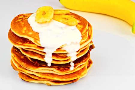 platanos fritos: Pancake with Banana, Pomegranate and Sour Cream Studio Photo