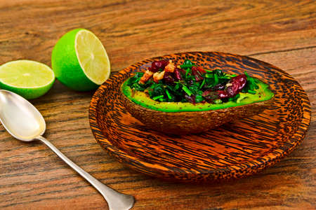 Avocado salad with herbs dill, parsley, cilantro, nuts and sun-dried cranberries Studio Photo