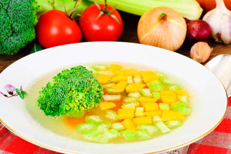 Chicken Soup with Broccoli, Carrots and Celery, Pumpkin and Noodles Studio Photo
