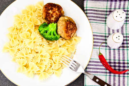 cutlets: Cutlets with Pasta and Broccoli Studio Photo Stock Photo