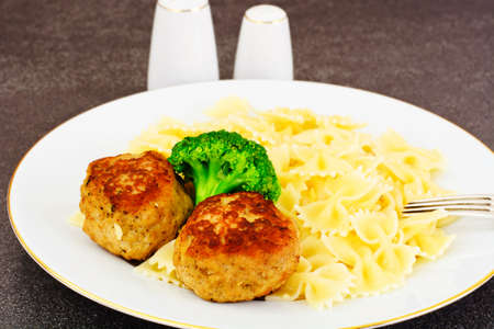 Cutlets with Pasta and Broccoli Studio Photo Stock Photo