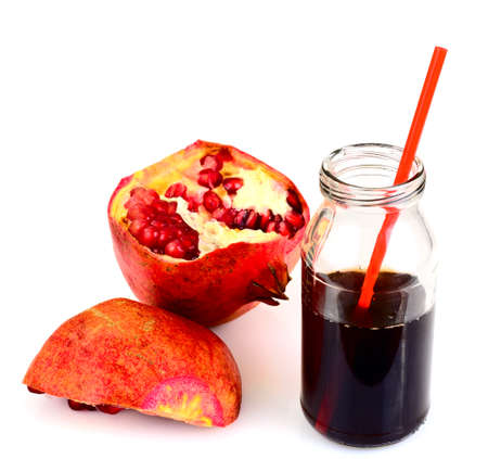 red tube: Natural Pomegranate Juice in Glass Jar with Red Tube and Broken Ripe Pomegranate on White Background. Studio Photo