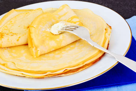 blini: Tasty Pancakes Stack with Butter Studio Photo Stock Photo
