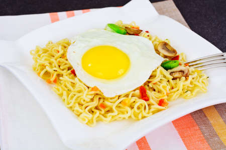 Chinese Noodles with Egg on Plate. Studio Photo