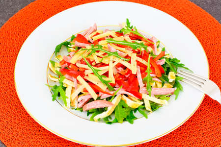 scrambled: Salad with Arugula, Scrambled Eggs, Ham, Cheese and Peppers Studio Photo