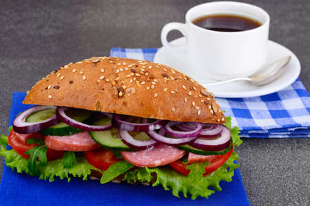 Healthy eating: Fresh sandwich with lettuce, tomato and onion. Studio Photo