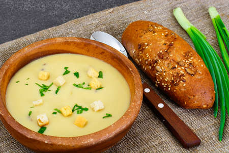 comfort food: Healthy, diet food: soup of potatoes with croutons, bread and greens. Studio Photo
