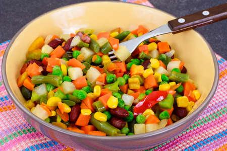 tortilla de maiz: Mexican Mix of Vegetables. Tomatoes, Beans, Celery Root, Green Beans, Peas and Corn. Dietary Food Foto de archivo