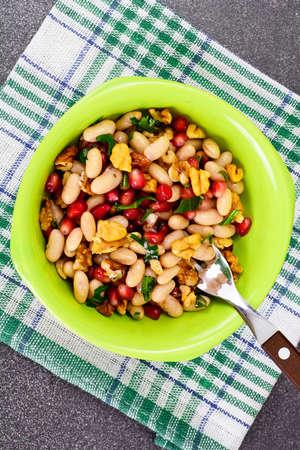 mung: White Beans with Pomegranates, Walnuts, Olive Oil, Lemon Juice Studio Photo Stock Photo