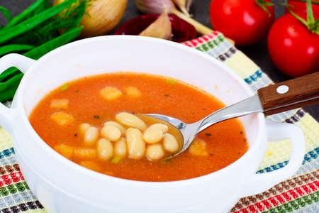 Sicilian Tomato Soup with White Beans. National Italian Cuisine. Studio Photo