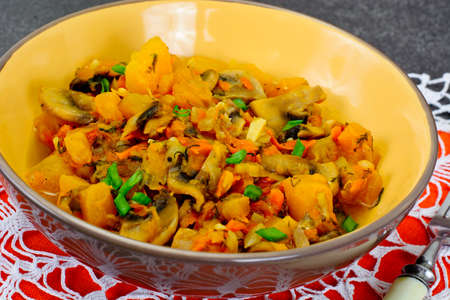 Baked Pumpkin with Mushrooms and Vegetables. Vegetarian Food. Studio Photo.