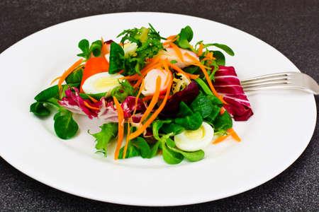 Frise Corn Salad with Chicory, Escarole, Crab Sticks and Quail Eggs EPS10