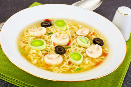 Tasty Mushroom Soup with Chinese Noodles. Studio Photo Stock Photo