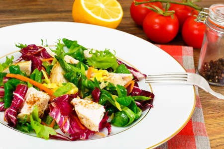 dietary: Salad Mix Batavian, Frise, Radicchio, Chicory  Chicken Dietary Meal Stock Photo
