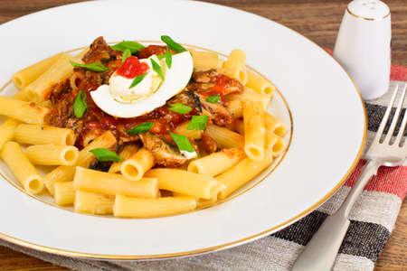 Tortellini with Tomato Paste, Sardines Fish,  Spices and Soy Sauce Studio Photo Stock Photo