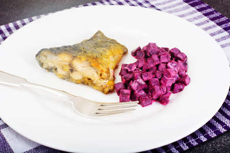 Fried Fish Cards and Salad of Boiled Beets with Yogurt Studio Photo