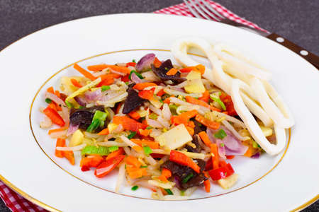soy sprouts: Healthy, diet: Mushrooms mun, bamboo shoots, soy sprouts, peppers and leeks with squid Studio Photo Stock Photo