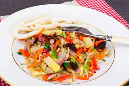 Healthy, diet: Mushrooms mun, bamboo shoots, soy sprouts, peppers and leeks with squid Studio Photo Stock Photo