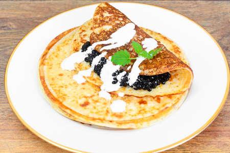 sturgeon: Pancakes with Black Caviar on Plate Studio Photo Stock Photo