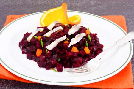 Beetroot Salad with Herring on Plate. Studio Photo