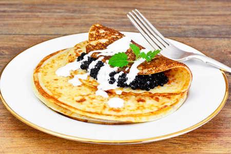 sturgeon: Pancakes with Black Caviar Studio Photo