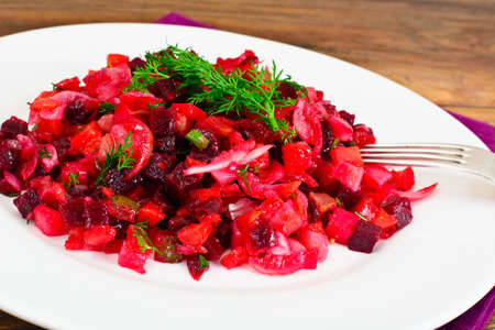 an onions: Healthy and Diet Food: Salad with Beets, Onions, Carrots - Vinaigrette. Studio Photo