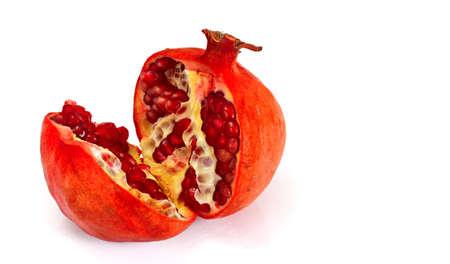 grained: Break Juicy Pomegranate Isolated on White Background. Studio Photo Stock Photo