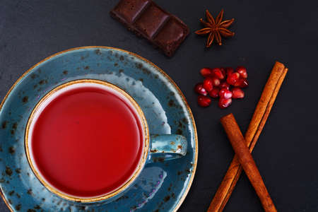 rooibos: Red Tea with beautiful cup, decorated with cinnamon and pomegranate. Studio Photo Stock Photo