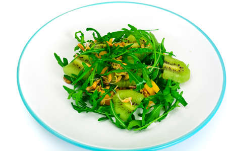Healthy and diet food without meat: Arugula, Sprouts, Peppers, Kiwi fruit and Vegetable oil. Studio Photo