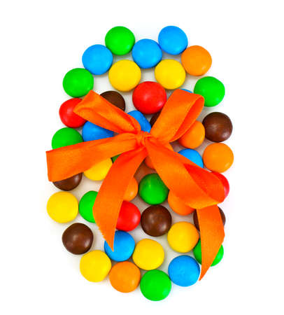 bonbons: Sweet Bonbons Candy in Easter Egg Form on White Background Studio Photo