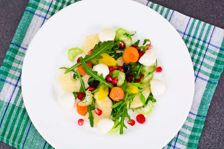par: Dietary Delicious Salad on White Plate of Arugula, Par, Walnut and Dried Cherry. Studio Photo