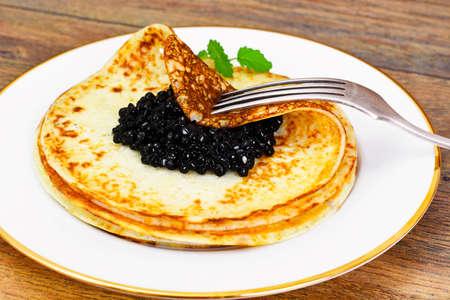 Pancakes with Black Caviar Studio Photo