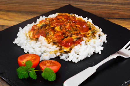 Rice with Canned Fish in Tomato Sauce Studio Photo Stock Photo